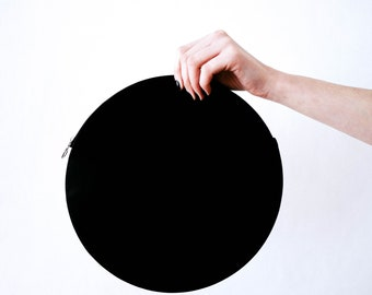 Round never used leather clutch