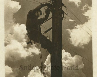 Electrical worker on pole vintage art photo