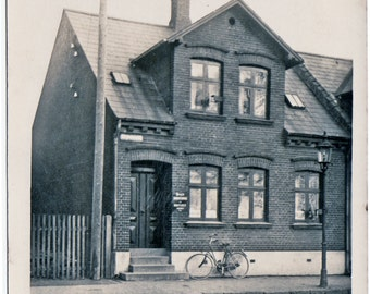 Bike Love in Denmark - Vintage Photo of Bike up Against a Building in 1926