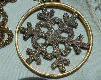 Yellow metal snowflake pendent