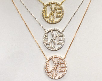 Love Necklace, Turn the Sparkle on with Top Quality Cubic Zirconia • Might Easily Become your Obsession Necklace
