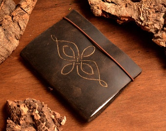 Dark leather notebook with Celtic symbol