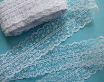 Lace trim ribbon. White doubled-edged lace.     44mm wide.  Haberdashery, millinery, craft projects, sewing supplies, wedding supplies