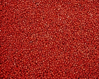 10 oz of 2 mm dark red seed beads