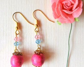 Dangle earrings in pink wooden beads with pink and blue swarovski crystals