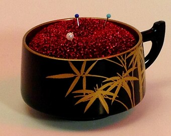 "Pincushion. Japanese Lacquered Cup With Golden Bamboo  3.25"" W by 1.75"" H,  2 oz net, #1920  Pin Cushion"