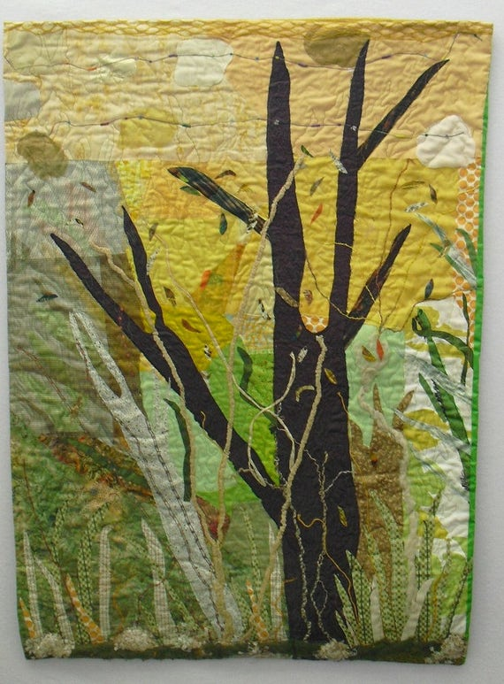 Fiber Art Wall Hanging fabric tree on a background of yellows