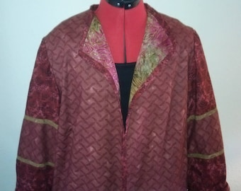 Reversible jacket with hand beading