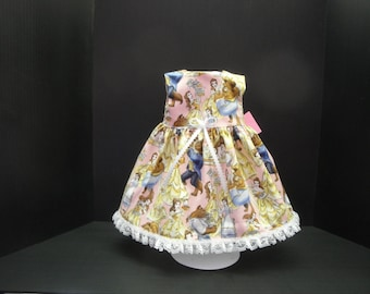 Beautiful sleeveless dress made to fit most 18 in dolls including American girl . The pattern is Beauty and the Beast.