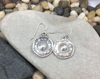 Hanging earrings, domed and flower patterned by stamping textures by hand