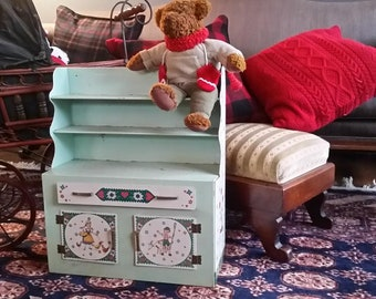 1950's tin hutch play kitchen with Dutch doll lithograph made by Wolverine.