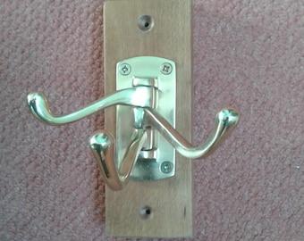 Upcycled space saving hardwood coat hook.