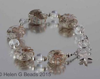 Sterling silver and lampwork clear and gold bracelet from the Jurassic coast range by Helen Gorick