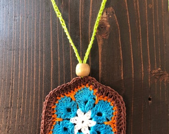 Crocheted African violet flower necklace