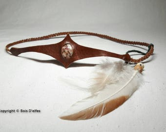 Tiaras in leather, feathers and genuine stone.