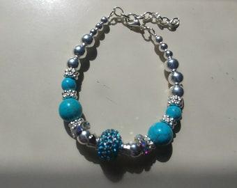 Set of silver beaded bracelet and earrings