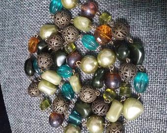 Multi colored beaded single Strand vintage necklace glass, brass and plastic beads