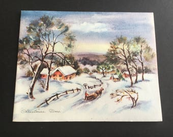 Vintage Christmas greeting card, snow houses, horse sled