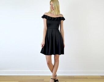 Ginger Knee Length Skater Dress with Shoulder Ruffle. Off-Shoulder Bardot Summer Dress. Jersey Midi Dress in Black