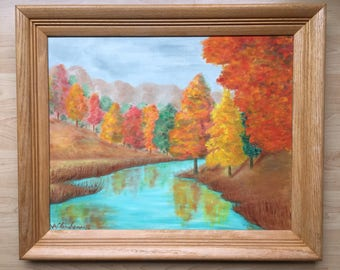 Vintage 60's original signed/dated A Clinehens 62, oil painting on board bright colorful fall trees, blue sky water/mountains scene. Framed