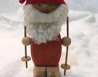 Vintage wood Santa Skiing