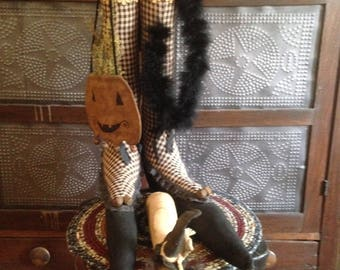 Primitive witch legs with shoes and witch mouse