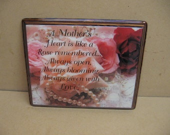 A Mother's Heart verse with roses and pearls, on a wood plaque.