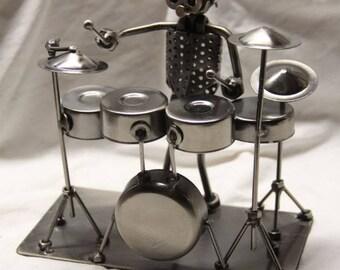 Miniature drummer novelty figurine.  All metal