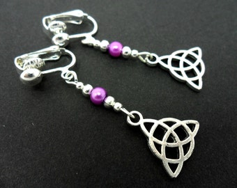 A pair of tibetan silver & purple glass bead celtic knot dangly clip on earrings. new.