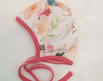 Pink watercolor flower pilot hat by Little Lapsi. Baby hat with ties. modern hearing aid