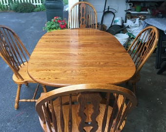Beautiful refinished solid oak dining table with 6 chairs