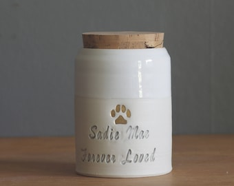 custom pet urn. script font shown, small collar shape. human ashes urn, pet urn. white on white porcelain. modern pottery urn, custom text