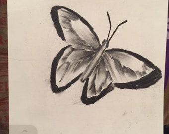 Slightly exploding butterfly-charcoal on sketch paper