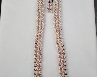 "Hawaiian three strand momi pikake and kahelelani lei with 3 1/2"" earrings, perfect for any occasion!"