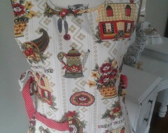 Old fashioned bib apron....smock style....reversible.....50s print