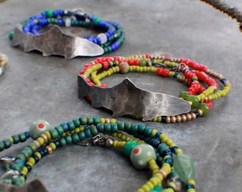 Hook, Line, Fish. Red and Chartreuse Green Wrap Bracelet with Sterling Steelhead Trout.