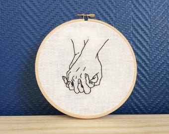 Hand in hand embroidery