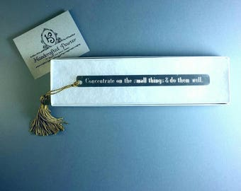 """Pewter Bookmark: """"Concentrate on the small things & do them well.""""  - Colin Cotterill"""