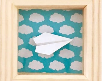 Origami airplane in a solid wood Frame