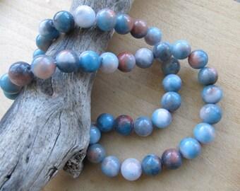 Set of 10 beads 10 mm diameter genuine jade dyed: variegated blue/taupe tones.
