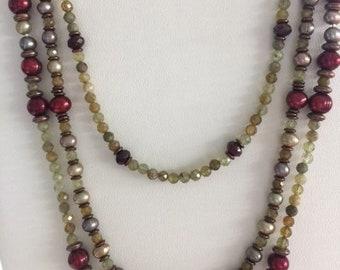 Triple strand pearls.