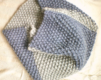 Hand knitted, light and dark blue infinity shoulder wrap