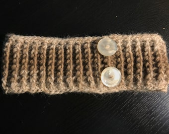Headband with buttons.