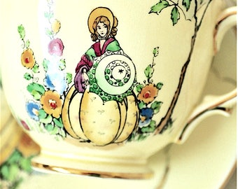 Crown Staffordshire Yellow Lady Teacup and Saucer Fine Bone China England '714104'