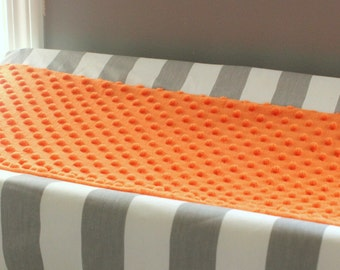 Contour Cover changing pad. Orange and gray minky.