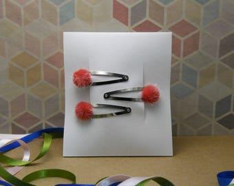 Set of three red pom pom hair clips