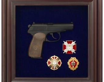 decoration of copy of Makarov gun with Ukranian awards