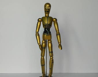C3PO style painted wooden mannequin