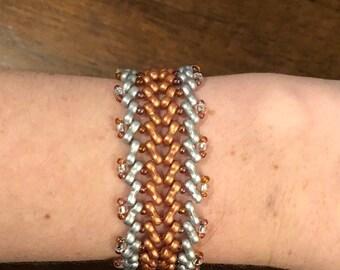 Silver and gold herringbone beaded bracelet