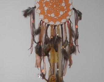 Orange dream catcher made on a metal circle